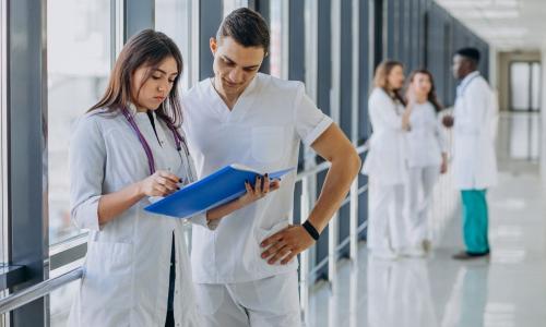 team-young-specialist-doctors-standing-corridor-hospital-1